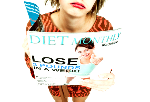 Disgusted Woman Reading Diet Magazine