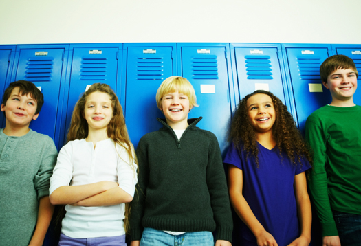 Smiling group of children in line at the school lockers