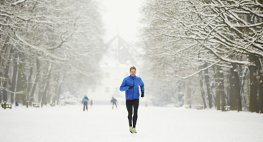 man jogging in the snow