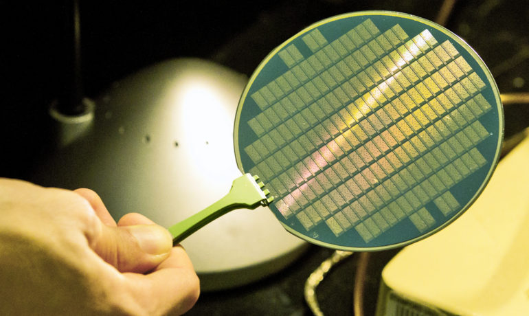 This wafer contains tiny computers using carbon nanotubes. The feat culminates years of efforts by scientists around the world to harness this promising but quirky material. (Credit: Norbert von der Groeben/Stanford University)