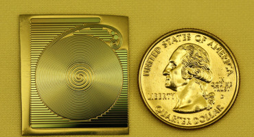 Researchers have developed a chip-based resonator in which photons travel around four spirals for more than a meter, but in an area about the size of a quarter—100 times longer than achieved in previous designs. (Credit: Hansuek Lee/Caltech)