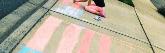 girl drawing flag