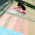 girl drawing flag