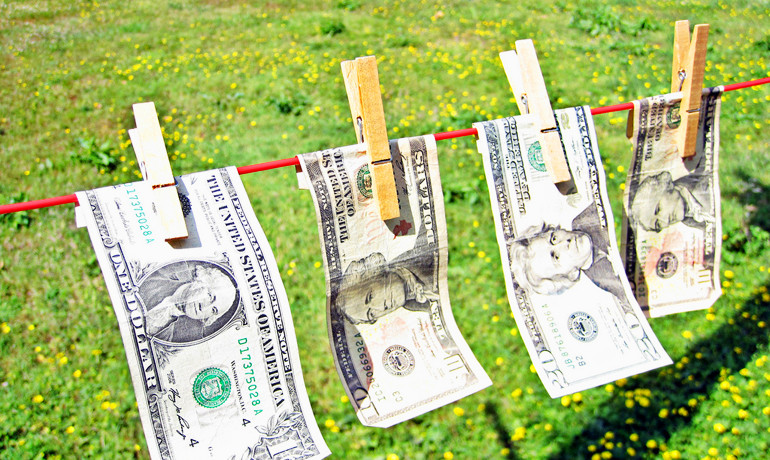 Looking ahead, analyists predict that over the next two decades demographic shifts will be an important factor pulling down the median household income for Americans. (Credit: Images Money/Flickr)