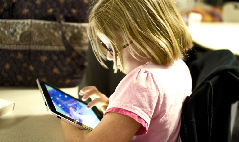 """For some parents, it was the first time they'd been able to converse with their children,"" says Ann Kaiser. ""With the onset of iPads, that kind of communication may become possible for greater numbers of children with autism and their families."" (Credit: Devon Christopher Adams/Flickr)"