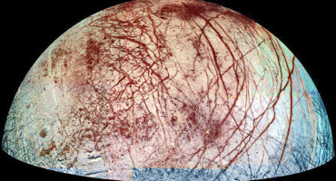 "The icy surface of Europa is shown strewn with cracks, ridges and ""chaotic terrain,"" where the surface has been disrupted and ice blocks have moved around. (Credit: NASA/JPL/University of Arizona)"