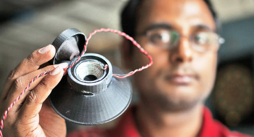 Apoorva Kiran holds a 3-D printed, fully functional loudspeaker. (Credit: Jason Koski/Cornell University Photography)