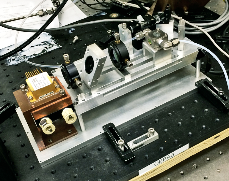 The QEPAS sensor can detect trace amounts of methane and nitrous oxide. The portable unit was tested during NASA's recent DISCOVER-AQ survey of Houston air quality and proved to be the equal of far larger instruments. (Credit: Rice University Laser Science Group)