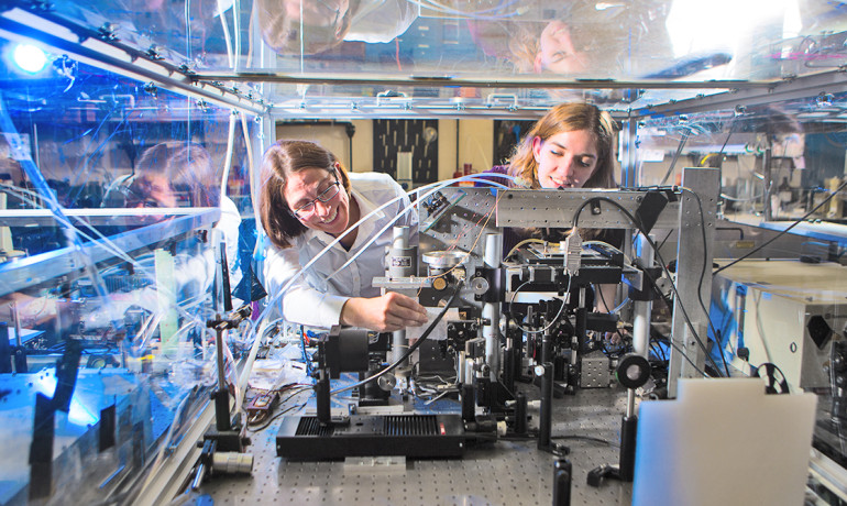 """People have been trying to measure these vibrations in proteins for many, many years, since the 1960s,"" says Andrea Markelz (left), who is pictured with Katherine Niessen. (Credit: Douglas Levere)"