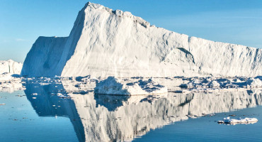 The speedup of Jakobshavn means that the glacier is adding more and more ice to the ocean, contributing to sea-level rise, says Ian Joughin. Above: Iceberg from Jakobshavn Glacier floating in Disko Bay. (Credit: Ian Joughin/APL)