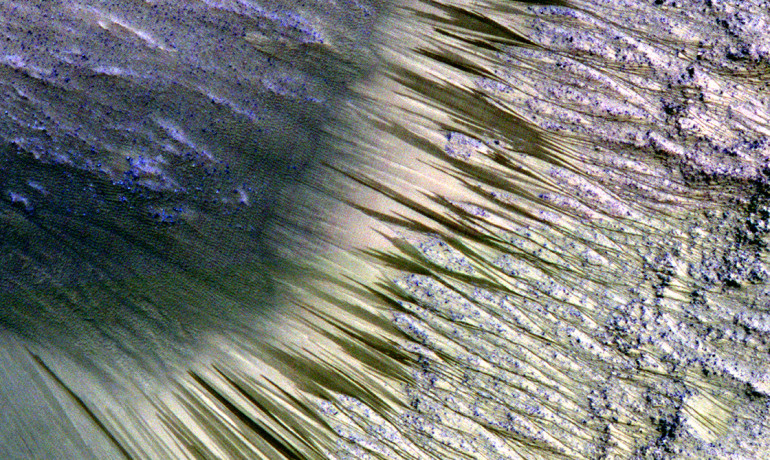 "Dark flow-like features, called recurring slope lineae, on Mars appear during warm seasons and fade or completely disappear in cold seasons. ""We still don't have a smoking gun for existence of water in RSL, although we're not sure how this process would take place without water,"" says Lujendra Ojha. (Credit: NASA/JPL-Caltech/Univ. of Arizona)"