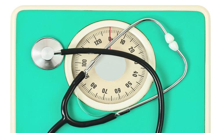"Doctors shouldn't come across to overweight patients as judgmental, but shouldn't avoid the subject of weight either, says Kimberly Gudzune. ""Many doctors avoid the conversation . . . but that is not in the patients' best interest."" (Credit: ""stethoscope on scale"" via Shutterstock)"