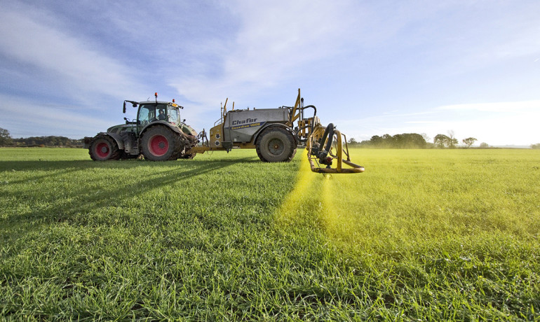 Farmers can cut down on herbicide drift by using low-volatility herbicide blends, which are less likely to turn to vapors, and use a nozzle design on the sprayer that produces larger droplets that do not easily drift in the wind, as well as spray on less windy day. (Credit: Chafer Machinery/Flickr)