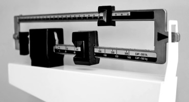 """Experiences of racism may explain in part the high prevalence of obesity among African-American women,"" explains Yvette C. Cozier. (Credit: ""weight scale"" via Shutterstock)"