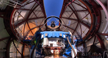 """This is an important next step in the search for exoplanets because imaging in visible light instead of infrared is what we likely have to do if we want to detect planets that might be suitable for harboring life,"" says Jared Maled. Above, the Magellan Telescope with the MagAO's Adaptive Secondary Mirror mounted at the top looking down some 30 feet onto the 21-foot diameter primary mirror, which is encased inside the blue mirror cell. (Credit: Yuri Beletsky, Las Campanas Observatory)"