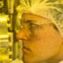 Graduate student Kent Hallman checks the sample alignment in the vapor deposition machine in Vanderbilt Institute for Nanoscale Science and Engineering's clean room. (Credit: Joe Howell/Vanderbilt)