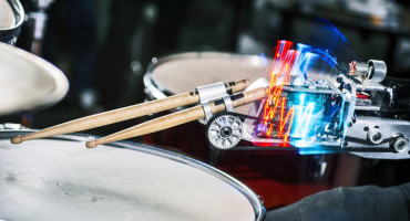 This robotic drumming prosthesis has motors that power two drumsticks. One is controlled by muscle sensors. The other is autonomous. (Credit: Georgia Tech)