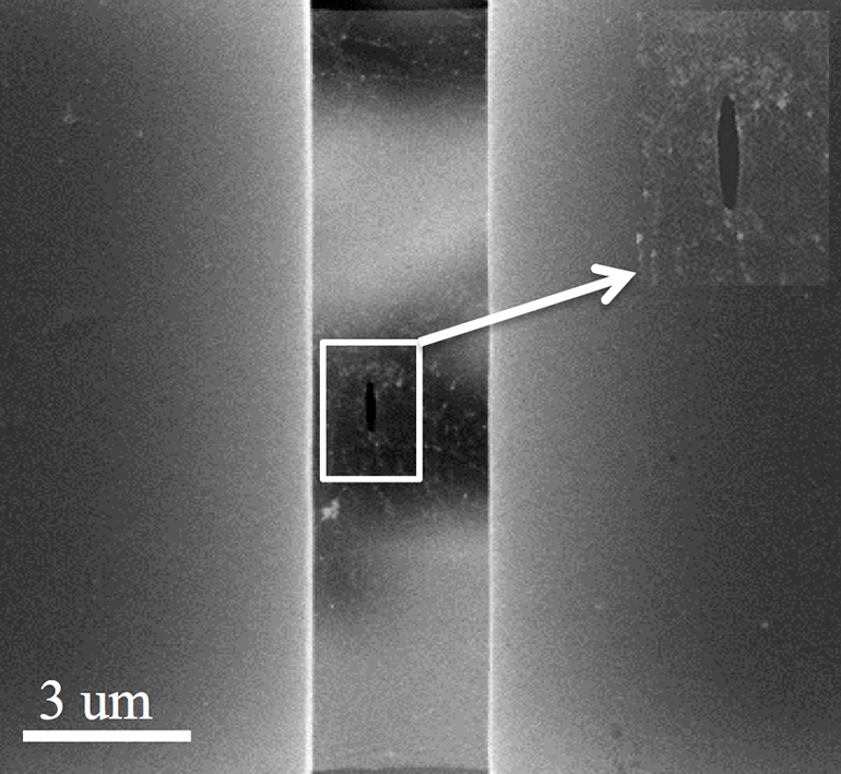 An electron microscope image shows a pre-crack in a suspended sheet of graphene used to measure the overall strength of the sheet. (Credit: The Nanomaterials, Nanomechanics and Nanodevices Lab/Rice University)