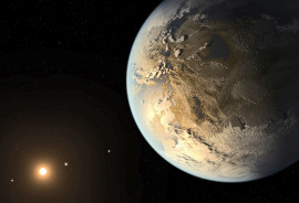 An artist's conception of the newly discovered exoplanet Kepler-186f orbiting the red dwarf star Kepler-186. The planet is the first Earth-sized world to be found orbiting a star at a distance that would allow it to harbor liquid water, a necessary ingredient for life as we know it. (Credit: NASA/Ames/JPL-Caltech/T. Pyle)