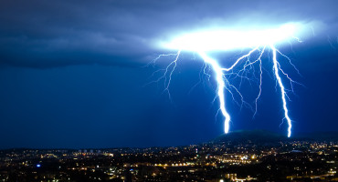 A new kind of laser beams that are more effective in overcoming scattering caused by atmospheric turbulence, water droplets in clouds, mist and rain, could be used to guide lightning away from buildings. (Credit: Håkon Sønderland/Flickr)