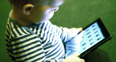 """""""The software has the potential to automatically analyze a child's eye gaze, walking patterns, or motor behaviors for signs that are distinct from typical development,"""" Amy Esler says. """"These signs would signal to doctors that they need to refer a family to a specialist for a more detailed evaluation."""" (Tia/Flickr)"""