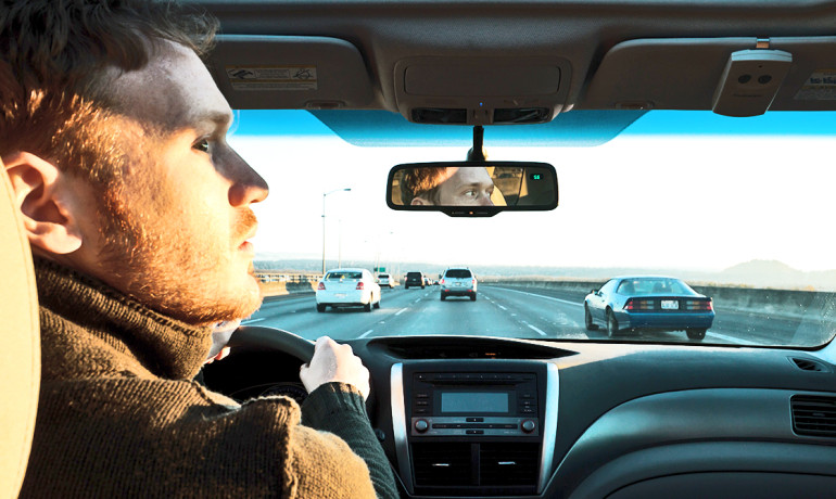 """A car in your rearview mirror that moves from one lane to the other doesn't suddenly disappear and then reappear on the other side,"" says Edward K. Vogel. ""The exchange is smooth, in part, because often the hemispheres coordinate a soft handoff."" (Credit: Andrew Catellier/Flickr)"