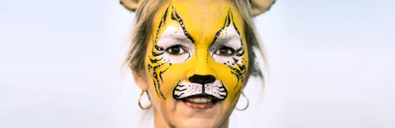 woman with tiger face paint