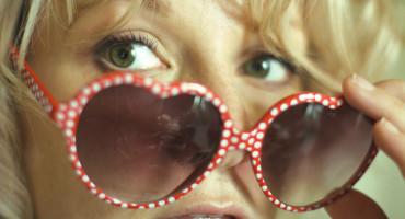 women glances over sunglasses