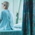 Senior man sitting on hospital bed