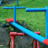 blue and red teeter-totter at playground