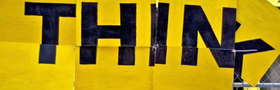"""yellow sign that says """"THINK"""""""