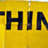 "yellow sign that says ""THINK"""
