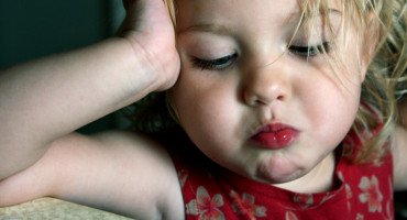 toddler pouts her mouth