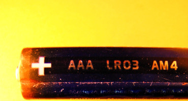 AAA battery on yellow background