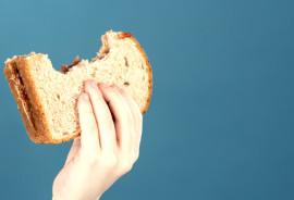 child holding a PB&J sandwich