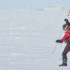 Melinda Webster measures snow depth in the Arctic