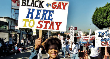 "protest sign ""black & gay here to stay"""