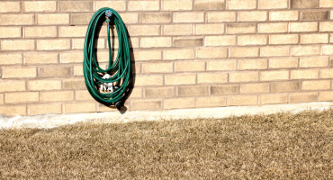 very dry lawn and garden hose