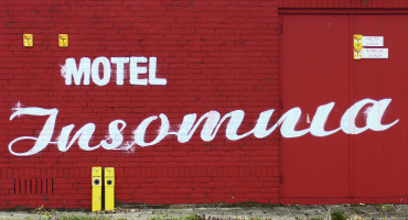 'Motel Insomnia' painted on a brick wall