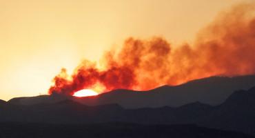 sun behind smoke