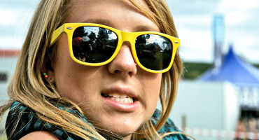 girl wearing yellow sunglasses