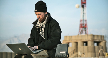 Journalist and photographer Jeremy Kelly, from Melbourne, Australia, files pictures via a BGAN satellite terminal from Foward Operating Base Tora.