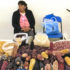 A woman sells a variety of maize in Tlaxcala, Mexico.