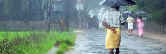 man walking in the rain