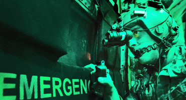 soldier wears night-vision goggles