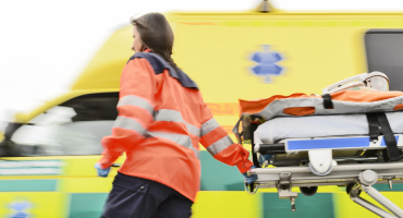 paramedic runs with a stretcher