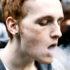 redheaded man exhales smoke