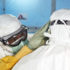 Ebola workers put on protective gear