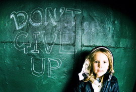 don't give up on wall behind child