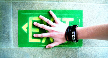 hand over an exit sign